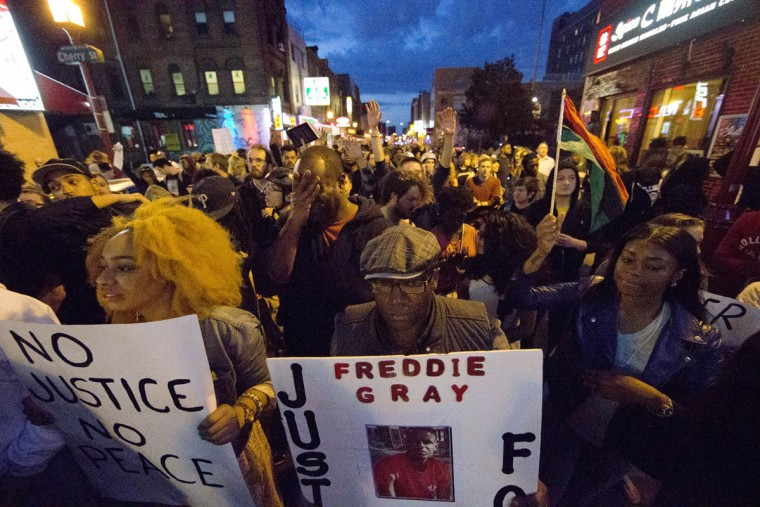 Protesters march after a rally at City Hall in Philadelphia on Thursday, April 30, 2015. The event in Philadelphia follows days of unrest in Baltimore amid Freddie Gray's police-custody death. (AP Photo/Matt Rourke)