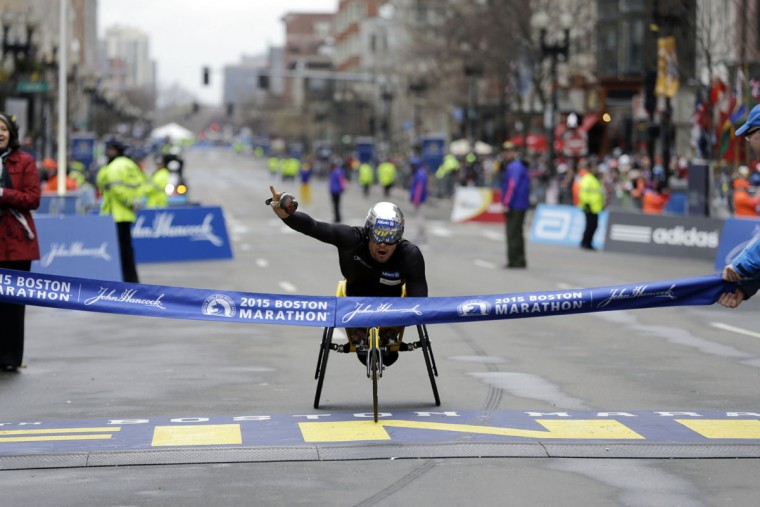 Marcel Hug, of Switzerland, crosses the finish line to win the wheelchair division of the Boston Marathon Monday, April 20, 2015 in Boston. (AP Photo/Elise Amendola)