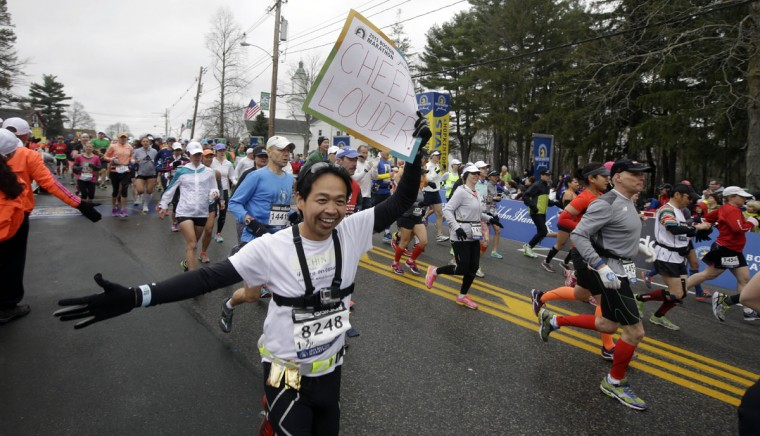 Runners including Chinh Le, foreground, of San Francisco, leave the start line of the Boston Marathon Monday, April 20, 2015 in Hopkinton, Mass. (AP Photo/Stephan Savoia)
