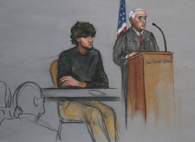 In this Jan. 5, 2015, file courtroom sketch, Boston Marathon bombing suspect Dzhokhar Tsarnaev, left, is depicted beside U.S. District Judge George O'Toole Jr., right, as O'Toole addresses a pool of potential jurors in a jury assembly room at the federal courthouse, in Boston. Lawyers for Boston Marathon bombing suspect Tsarnaev have asked a judge three times to move his trial out of Massachusetts because of the emotional impact of the deadly attack. Three times, the judge has refused. On Thursday, Feb. 19, Tsarnaevís defense team will ask a federal appeals court to take the decision out of the hands of OíToole Jr. and order him to move the trial. They insist that Tsarnaev cannot find a fair and impartial jury in Massachusetts because too many people believe heís guilty and many have personal connections to the marathon or the bombings. (AP Photo/Jane Flavell Collins, File)