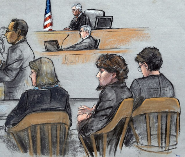 In this courtroom sketch, Assistant U.S. Attorney Aloke Chakravarty, left, is depicted addressing the jury as defendant Dzhokhar Tsarnaev, second from right, sits between his defense attorneys during closing arguments in Tsarnaev's federal death penalty trial Monday, April 6, 2015, in Boston. Tsarnaev is charged with conspiring with his brother to place two bombs near the Boston Marathon finish line in April 2013, killing three and injuring 260 people. (AP Photo/Jane Flavell Collins)