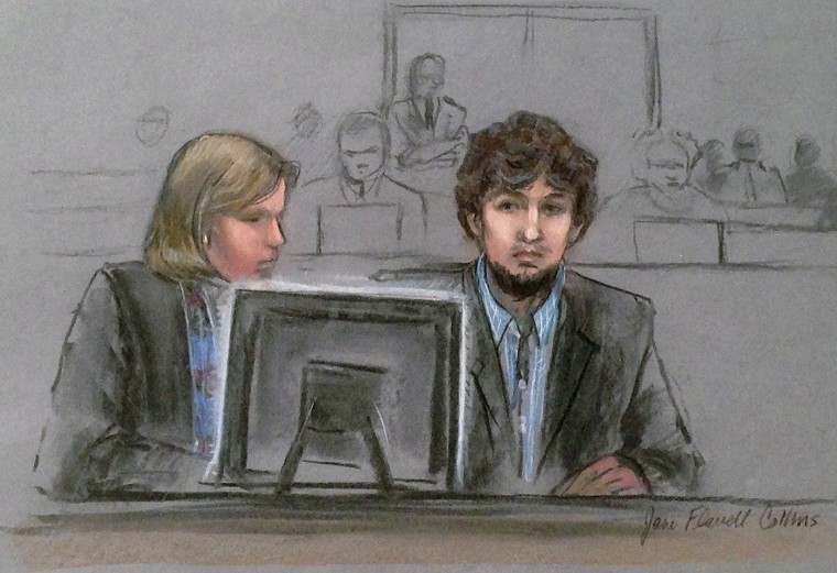 In this courtroom sketch, Dzhokhar Tsarnaev, right, and defense attorney Judy Clarke are depicted watching evidence displayed on a monitor during his federal death penalty trial Monday, March 9, 2015, in Boston. Tsarnaev is charged with conspiring with his brother to place two bombs near the marathon finish line in April 2013, killing three and injuring 260 spectators. (AP Photo/Jane Flavell Collins)