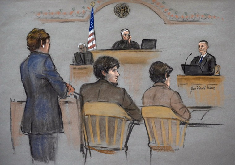 In this courtroom sketch, Bill Richard, right, is depicted while testifying during the federal death penalty trial of Dzhokhar Tsarnaev, second from left, Thursday, March 5, 2015, in Boston. Tsarnaev is depicted sitting between defense attorneys Judy Clarke, left, and Miriam Conrad, second from right, as U.S. District Judge George O'Toole Jr., presides, center rear. Tsarnaev is charged with conspiring with his brother to place two bombs near the Boston Marathon finish line in April 2013, killing three spectators, including Bill Richard's son Martin Richard. (AP Photo/Jane Flavell Collins)