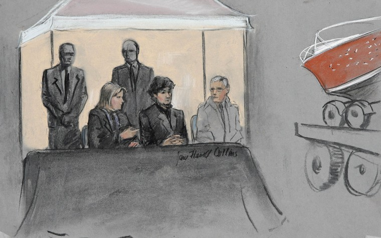 In this courtroom sketch, Dzhokhar Tsarnaev, center seated, is depicted between defense attorneys while the boat in which he was captured in sits on a trailer for observation during his federal death penalty trial, Monday, March 16, 2015, in Boston. Tsarnaev is charged with conspiring with his brother to place two bombs near the Boston Marathon finish line in April 2013, killing three and injuring more than 260 people. (AP Photo/Jane Flavell Collins)