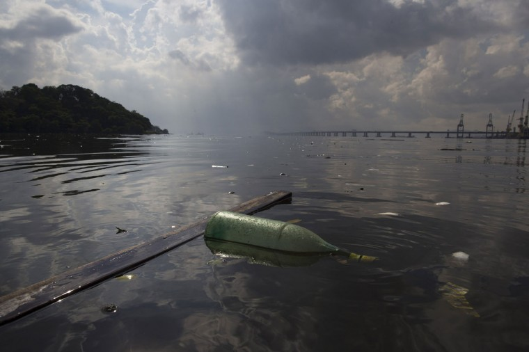 In this Feb. 28, 2015 photo, a bottle and wood floats with other trash in Guanabara bay in Rio de Janeiro, Brazil. Rio state authorities say theyíre working to make good on a pledge made in Rioís Olympic bid to cut the bayís pollution by 80 percent. The bay will host Olympic sailing events in 2016. (AP Photo/Leo Correa)