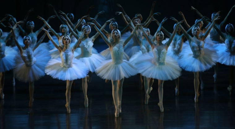 "Dancers of the Joburg Ballet and the Liaoning Ballet of China company take part in a final dress rehearsal, in Johannesburg, South Africa, Thursday, April 16, 2015 ahead of a two week run of performances of ""Swan Lake"" which gets under way at the Joburg Theater Friday. (AP Photo/Denis Farrell)"