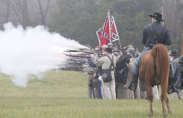 Confederate troops fire muskets at Union troops during a re-enactment of the Battle of Appomattox Courthouse as part of the commemoration of the 150th anniversary of the surrender of the Army of Northern Virginia at Appomattox Court House in Appomattox, Va., Thursday, April 9, 2015. The battle was the final battle of the army of Confederate General Robert E. Lee before his surrender to Union troops. (AP Photo/Steve Helber)