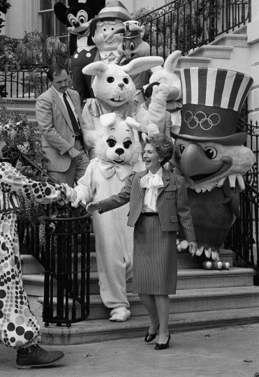 In this April 20, 1981, file photo first lady Nancy Reagan leads a group of cartoon characters to the South Lawn of the White House Monday for the annual Easter Egg Roll. (AP Photo/Barry Thumma, File)