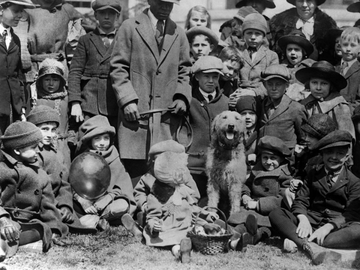 In the absence of President and Mrs. Harding April 2, 1923, for the annual White House Easter egg roll, the first family's pet airedale Laddie Boy acted as host for the many children who rolled eggs on the White House lawn. (AP Photo/Library of Congress)