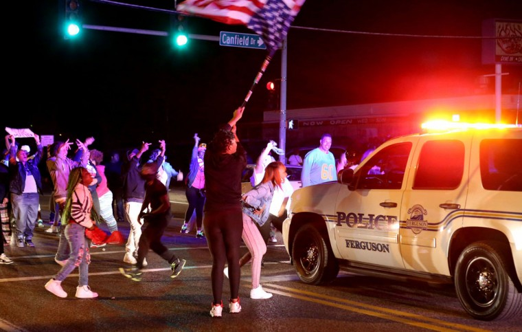 Protesters block the intersection of West Florissant Avenue and Canfield Drive in Ferguson, Mo., Tuesday night, April 28, 2015. Looting, fires and gunfire broke out overnight in Ferguson during protests in response to the death of Freddie Gray in police custody in Baltimore. (David Carson/St. Louis Post-Dispatch via AP)