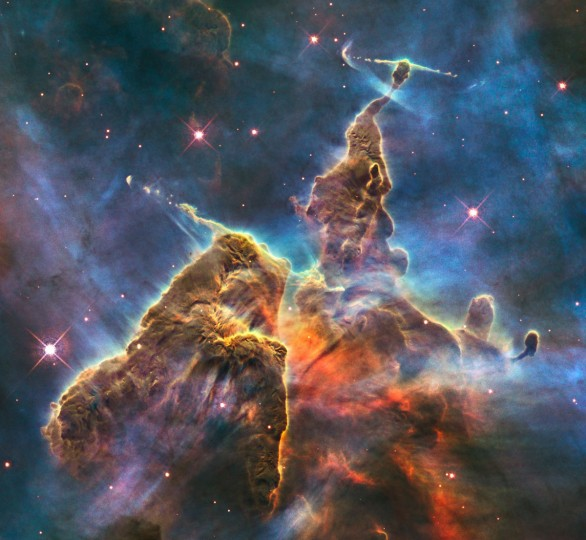 This February 2010 image made by the NASA/ESA Hubble Space Telescope shows a three-light-year-tall pillar of gas and dust in the Carina Nebula which is being eaten away by the light from nearby bright stars. (NASA/ESA, M. Livio, Hubble 20th Anniversary Team via AP)