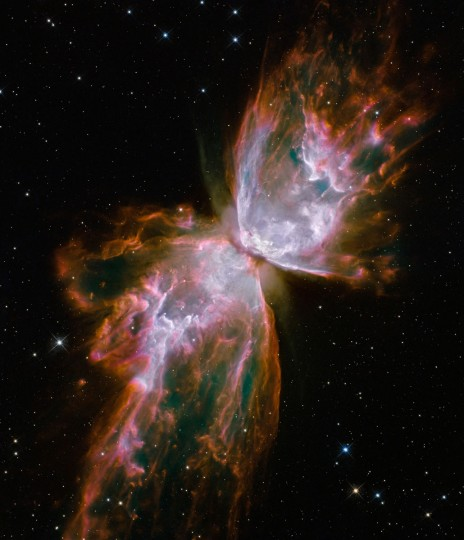 """This Hubble image shows jets of gas heated to nearly 20,000 degrees Celsius traveling at more than 59,000 miles per hour streaming from the dying star NGC 6302, the """"Butterfly Nebula"""" in the Milky Way galaxy. (NASA/ESA/Hubble SM4 ERO Team via AP)"""