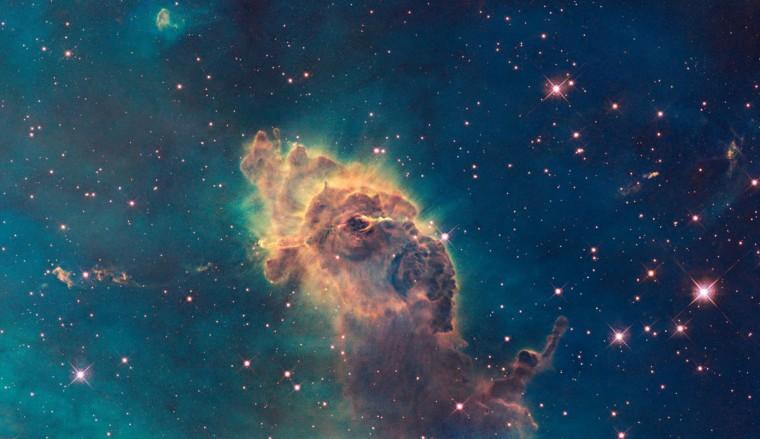 This Hubble image shows the tip of the three-light-year-long pillar in a stellar nursery called the Carina Nebula. (NASA/ESA/Hubble SM4 ERO Team via AP)