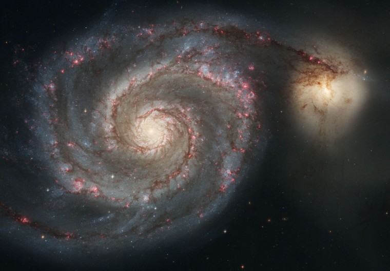 The Whirlpool Galaxy (M51) and a companion galaxy is shown in this Hubble image. The Whirlpool's curving arms compress hydrogen gas and create clusters of new stars. (NASA, ESA, S. Beckwith (STScI), Hubble Heritage Team STS via AP)