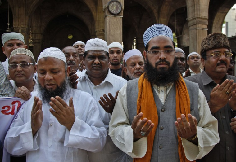 Indian muslims offer prayers for victims of Nepal's earthquake, in Ahmadabad, India, Monday, April 27, 2015. The earthquake was the worst to hit the South Asian nation in more than 80 years. It and was strong enough to be felt all across parts of India, Bangladesh, China's region of Tibet and Pakistan. (AP Photo/Ajit Solanki)