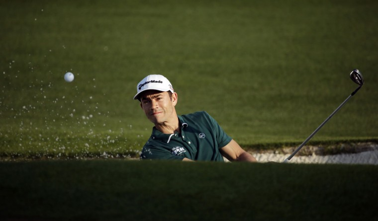 Camilo Villegas, of Colombia, hits out of a bunker on the second fairway during the first round of the Masters golf tournament Thursday, April 9, 2015, in Augusta, Ga. (AP Photo/Chris Carlson)
