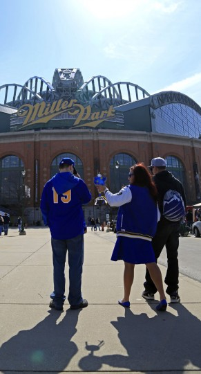 Fans get ready to enter the Miller Park before the start of an opening day game between the Milwaukee Brewers and the Colorado Rockies Monday, April 6, 2015 in Milwaukee. (AP Photo/Darren Hauck)