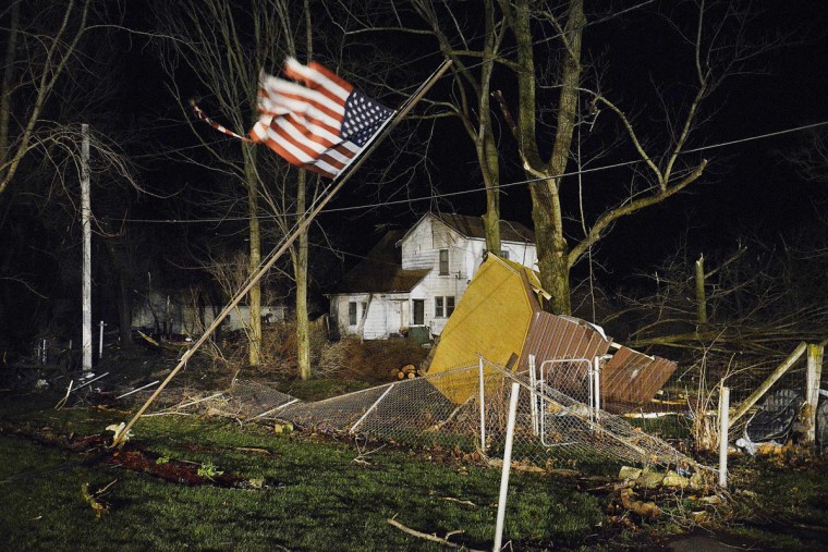 Damage is seen after a tornado struck the small town of Fairdale Ill. the night of Thursday, April 9, 2015. Supercell thunderstorms produced a large tornado that touched down Thursday night in northern Illinois, killing one person and injuring seven others in one tiny community as severe weather pummeled the Midwest. Every home in the town was affected, authorities said. DeKalb County Sheriff Roger Scott said in a news release that approximately 15 to 20 were totally destroyed. (AP Photo/Daily Herald, John Starks)