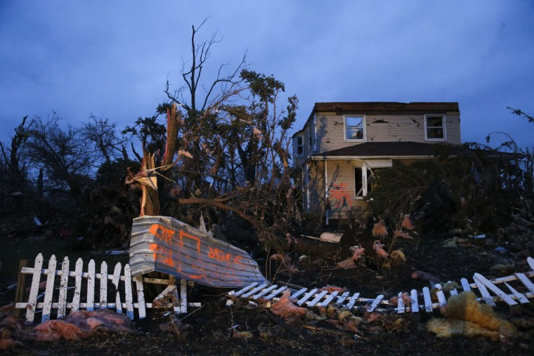 A home is covered with debris after a late night tornado passed through the area, Friday, April 10, 2015 in Fairdale, Ill. The National Weather Service says at least two tornadoes churned through six north-central Illinois counties. (AP Photo/Chicago Tribune, Armando L. Sanchez)