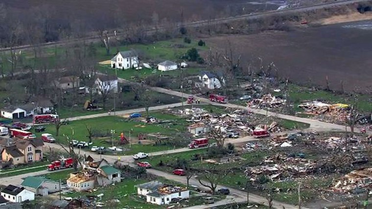 This Friday, April 10, 2015 aerial image made from video provided by ABC 7 Chicago (WLS-TV) over Fairdale, Ill., shows damage after a tornado blew through the area Thursday evening. The National Weather Service says at least two tornadoes churned through six north-central Illinois counties. (AP Photo/Courtesy of ABC 7 Chicago (WLS-TV) ORG XMIT: CX103