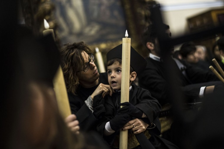 "Young penitents prepare to take part in the procession of the ""Silencio del Santisimo Cristo del Rebate"" brotherhood, during Holy Week in Tarazona, northern Spain, Tuesday, March 31, 2015. Hundreds of processions take place throughout Spain during the Easter Holy Week. (AP Photo/Alvaro Barrientos)"