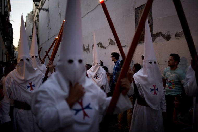 "Hooded penitents from the ""Dulce Nombre"" take part in a procession in Seville, Spain, Tuesday, March 31, 2015. Hundreds of processions take place throughout Spain during the Easter Holy Week. (AP Photo/Emilio Morenatti)"