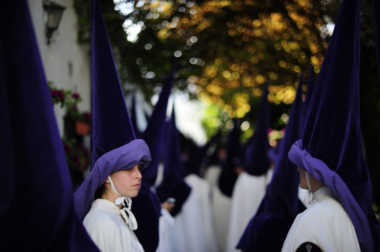 "Penitents from ""La Sangre"" brotherhood participate in a Holy Week procession in Cordoba, Spain, Tuesday, March 31, 2015. Hundreds of processions take place throughout Spain during the Easter Holy Week. (AP Photo/Manu Fernandez)"