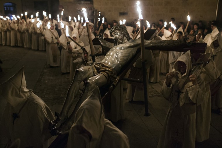 Penitents from 'Cristo de la Buena Muerte' or 'Good Dead Christ' brotherhood carry a Jesus Christ figure as they take part in a procession in Zamora, Spain, early Tuesday, March 31, 2015. Hundreds of processions take place throughout Spain during the Easter Holy Week. (AP Photo/Andres Kudacki)