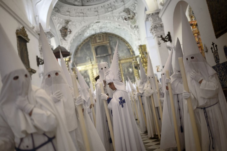 "Penitents take part in ""Nuestro Senor Atado a la Columna, Maria Santisima de la Paz y San Juan Evangelista"" Holy Week procession in Arcos de la Frontera, Spain, Tuesday, March 31, 2015. Hundreds of processions take place throughout Spain during the Easter Holy Week. (AP Photo/Daniel Ochoa de Olza)"