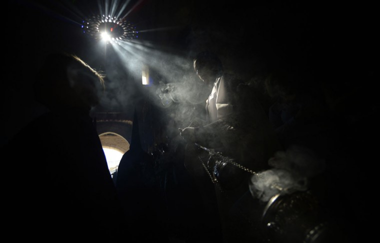 "A penitent from ""El Calvario"" brotherhood takes part during a Holy Week procession in Cordoba, Spain, Wednesday, April 1, 2015. Hundreds of processions take place throughout Spain during the Easter Holy Week. (AP Photo/Manu Fernandez)"