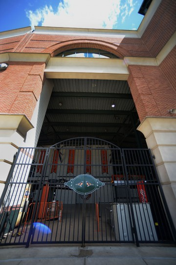 An empty Oriole Park is photographed from the outside before the Chicago White Sox and Baltimore Orioles baseball game, Wednesday, April 29, 2015, in Baltimore. Due to security concerns the game was closed to the public. (AP Photo/Gail Burton)