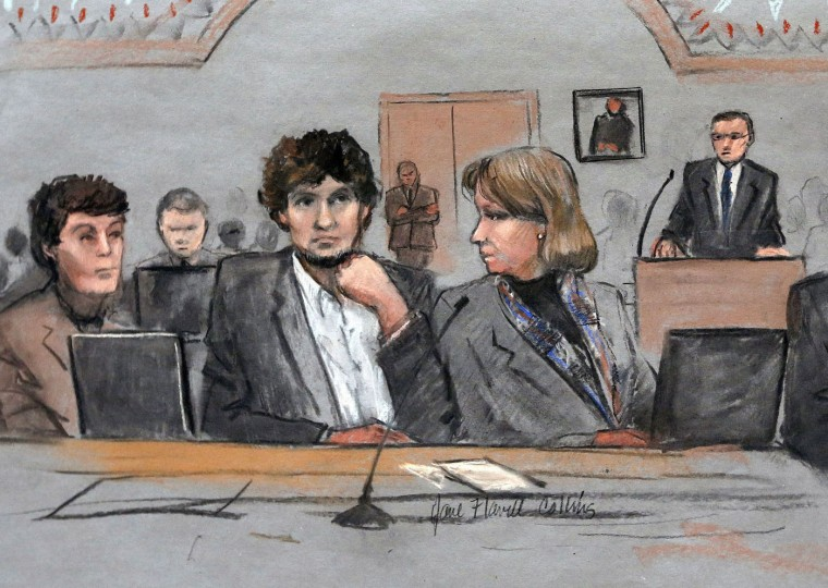 In this March 5, 2015 file courtroom sketch, Dzhokhar Tsarnaev, center, is depicted between defense attorneys Miriam Conrad, left, and Judy Clarke, right, during his federal death penalty trial in Boston. Prosecutors rested their case against Tsarnaev on Monday, March 30, 2015, after jurors saw gruesome autopsy photos and heard a medical examiner describe the devastating injuries suffered by the three people who died in the 2013 terror attack. (AP Photo/Jane Flavell Collins, File)