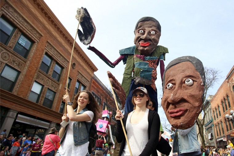 Participants march down Main Street during Festifools in downtown Ann Arbor, Mich. (Patrick Record/The Ann Arbor News via AP)