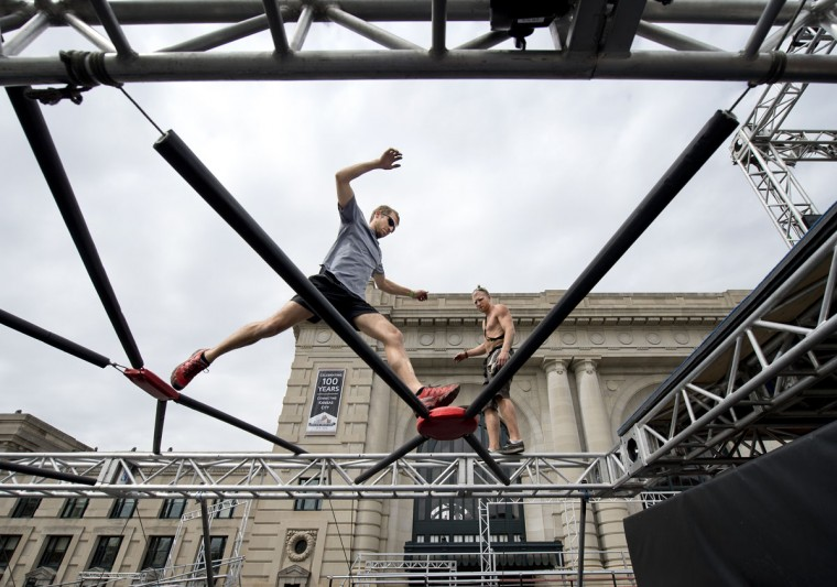 Nate Moore, left, and Kyle DesChamps begin testing the course as construction continued nearby for NBC's American Ninja Warrior, Tuesday, April 14, 2015 in Kansas City, Mo. (Keith Myers/The Kansas City Star via AP)