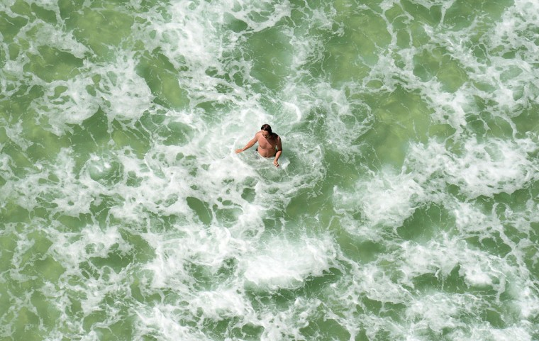 A man enjoys the water in Panama City Beach, Fla., on Wednesday, April 22, 2015. (Andrew Wardlow/News Herald via AP)