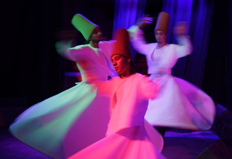 "Egyptian whirling dervishes dance in traditional costumes as they perform Sufi dance known as ""whirling dervish."" in Cairo, Egypt, Thursday, April 23, 2015. Whirling dervishes of al-Tannura entertain visitors with their colorful and artistic spinning dance. (AP Photo/Amr Nabil)"