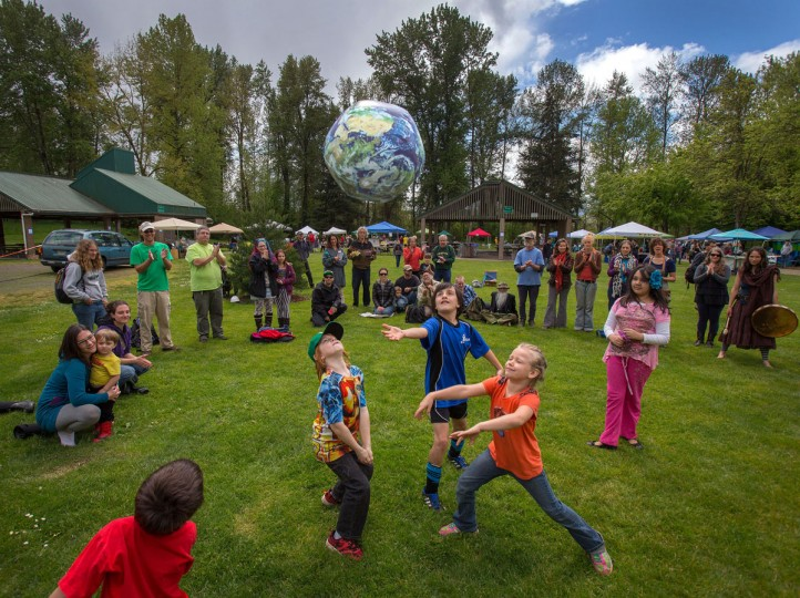 Children celebrate a spirited Earth Day at Alton Baker Park in Eugene, Ore. Saturday, April 25, 2015. The event, celebrating the 45th anniversary of the first Earth Day in 1970, featured sustainability workshops, activities for children, a plant sale, music and dancing. (Brian Davies/The Register-Guard via AP)