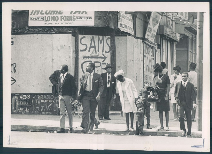 Along Pennsylvania Avenue, stores were boarded or burnt for Easter. 1968 riots. Weyman Swagger.