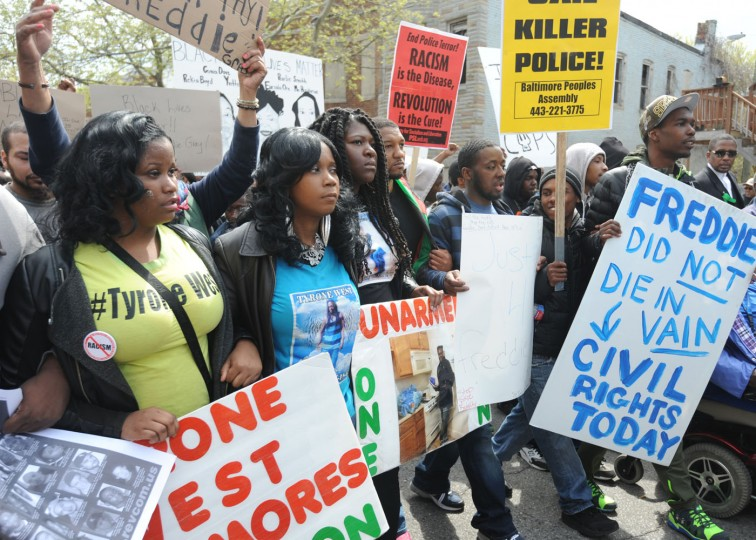 Second from left, Tawanda Jones, sister of Tyrone West, who died while in police custody in 2013, takes part in the march to protest the death of Freddie Gray, who was in police custody. (Kim Hairston/Baltimore Sun)