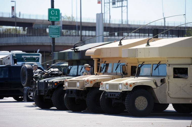 Maryland National Guard vehicles at the command post in the parking lot between Oriole Park and Ravens stadium. Kim Hairston/The Baltimore Sun