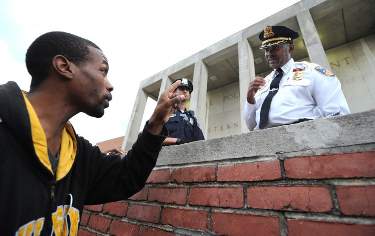 Travis Robertson of Baltimore has a few words with Lt. Col. Melvin Russell outside of the Western District Police Station. Protest outside of the Western District Police Station after Freddie Gray died while in police custody. Lloyd Fox/Baltimore Sun