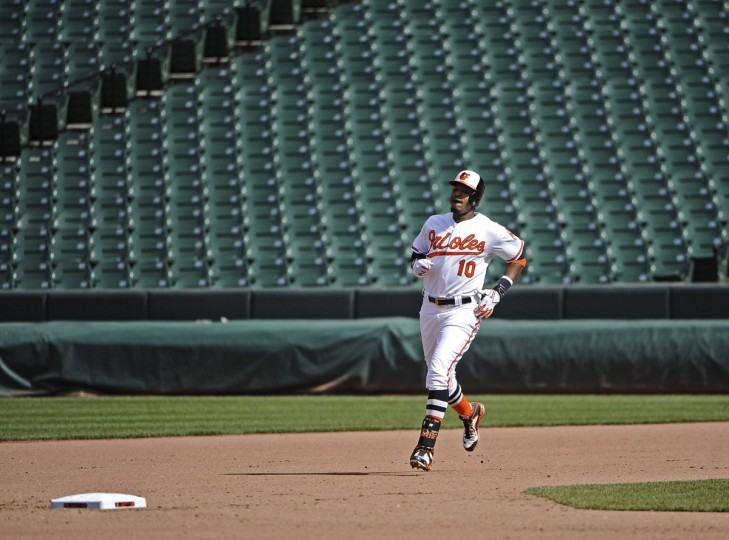 Orioles' Adam Jones runs to second base on a double in the eighth inning. The Orioles defeated the Chicago White Sox by score of 8 to 2 in an empty Oriole Park at Camden Yards on Wednesday. The game was played in two hours and three minutes. The first two games of the series were cancelled due to the wide spread riots and looting on Monday in Baltimore resulting from protest over the death of Freddie Gray. (Kenneth K. Lam/Baltimore Sun)