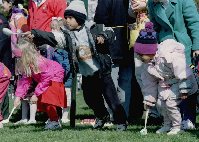 Christian Stelter lunges forward as he gets a jump on the field at the start of the White House Easter Egg roll April 8 on the South Lawn. President Clinton welcomed thousands of youngsters to the perennial rite of spring. (Photo by Win McNamee/Reuters)