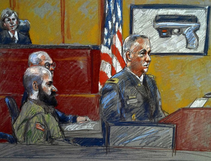 Prosecutor Colonel Steve Henricks (R) speaks to jurors on the opening day of the trial of Major Nidal Hasan (L, front), as military judge Colonel Tara Osborn (L, top) sits on the bench, as seen in a courtroom sketch at the U.S. Army post in Fort Hood, Texas, August 6, 2013. Hasan is representing himself at his long-awaited trial for killing 13 U.S. soldiers in 2009. The man sitting next to Hasan is not identified. REUTERS/Brigitte Woosley