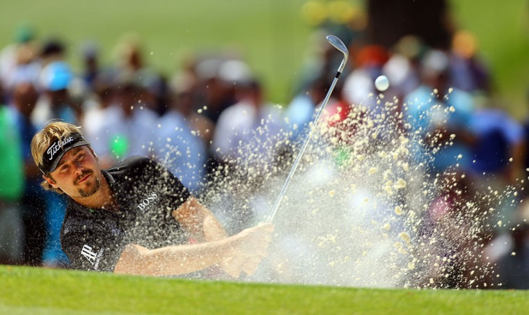 Victor Dubuisson hits from the bunker to the #7 green during the first round at the Masters Golf Tournament, Thursday, April 9, 2015 in Augusta, Ga. (Curtis Compton/Atlanta Journal-Constitution/TNS)