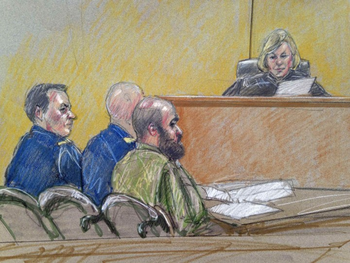 Army Major Nidal Hasan (C), accused of killing 13 soldiers in a 2009 Fort Hood shooting rampage, is seen in a courtroom sketch as he sits with his legal team in front of military judge Colonel Tara Osborn at his court martial at Fort Hood, Texas July 9, 2013. Hasan, 42, an American-born Muslim who faces the death penalty if convicted by a military panel. REUTERS/Brigitte Woosley