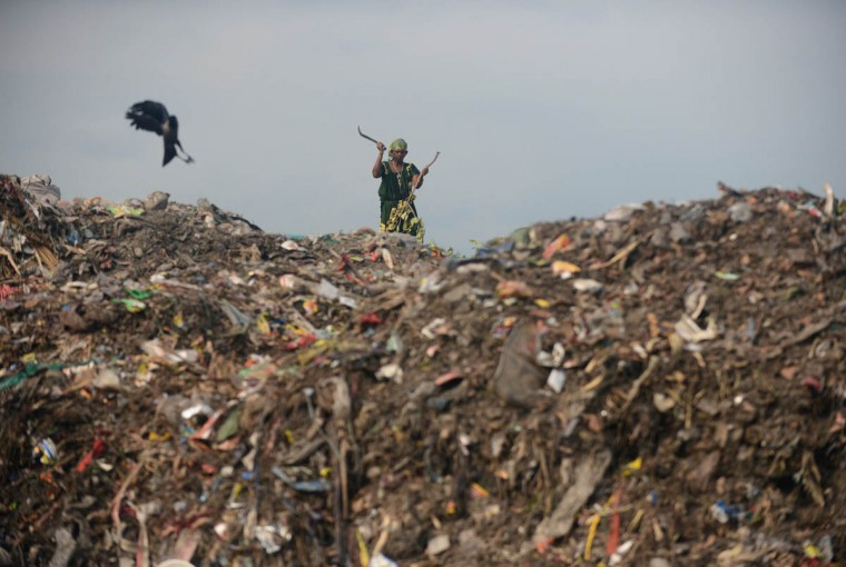 An Indian female ragpicker hacks up wood at a garbage dump yard on the outskirts of Siliguri on Earth Day. Earth Day is observed each April 22, during which events are held worldwide to demonstrate support for environmental protection.(Diptendu Dutta/AFP/Getty Images)