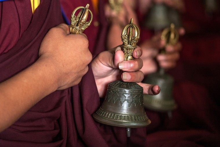 Buddhist monks hold bells during a memorial organized in the Lhundrup Choeling monastery in memory of Ang Kaji Sherpa, one of the 16 sherpas who died in the Everest Avalanche one year ago in Kathmandu, Nepal. Friends and family of the 16 Sherpas who lost their lives one year ago in an avalanche on Mt. Everest gathered on today for a tribute in memory of those lost. On the morning of April 18, 2014, an avalanche killed the 16 Sherpas who were carrying gear up the mountain and led to growing demands for better pay and death and injury benefit payouts to the families of Sherpas. (Omar Havana/Getty Images)