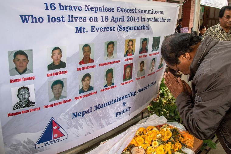 A man pays tribute during a memorial organized by the Nepal Mountaineering Association for the 16 sherpas who lost their lives one year ago in the Everest avalanche in Kathmandu, Nepal. Friends and family of the 16 Sherpas who lost their lives one year ago in an avalanche on Mt. Everest gathered on today for a tribute in memory of those lost. On the morning of April 18, 2014, an avalanche killed the 16 Sherpas who were carrying gear up the mountain and led to growing demands for better pay and death and injury benefit payouts to the families of Sherpas. (Omar Havana/Getty Images)