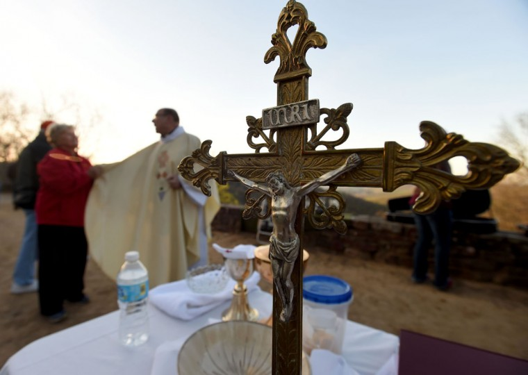 Father Joseph Lubrano greets parishioners on Monte Sano, a prominent north Alabama mountain, during a sunrise Easter service Sunday, April 5, 2015, in Huntsville, Ala. (AP Photo/Eric Schultz, AL.com)